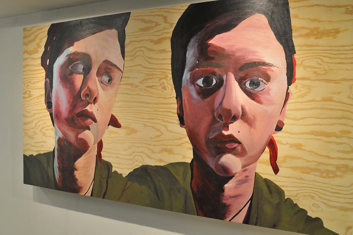 Student self portrait painting on wood