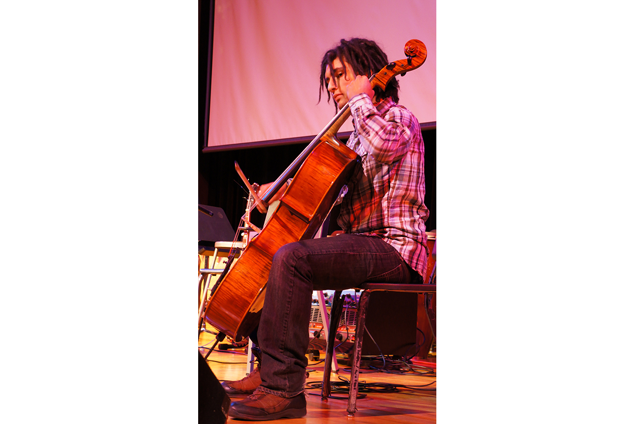 Cellist performing on stage
