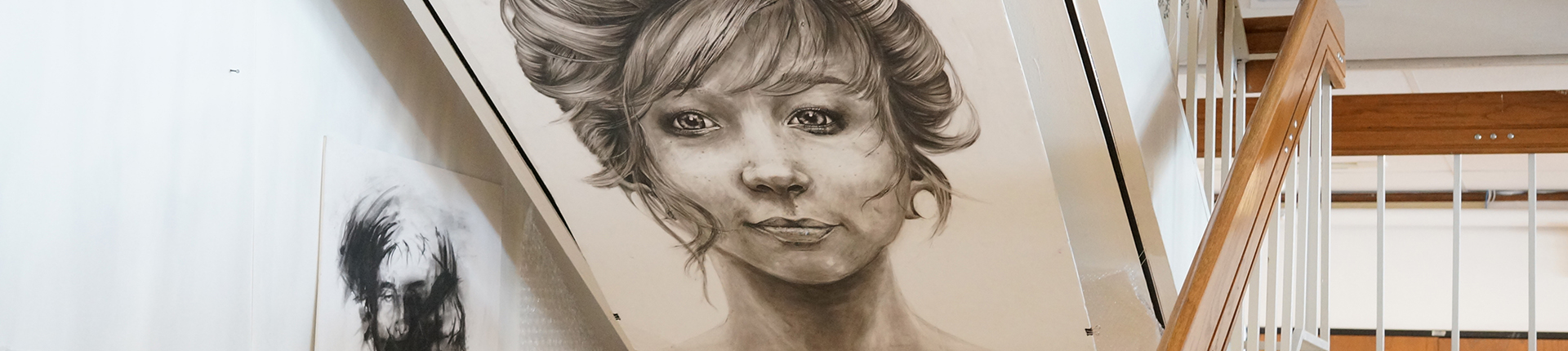 Pencil drawing hanging in staircase