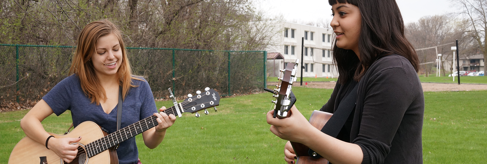 Two girls playing guitars