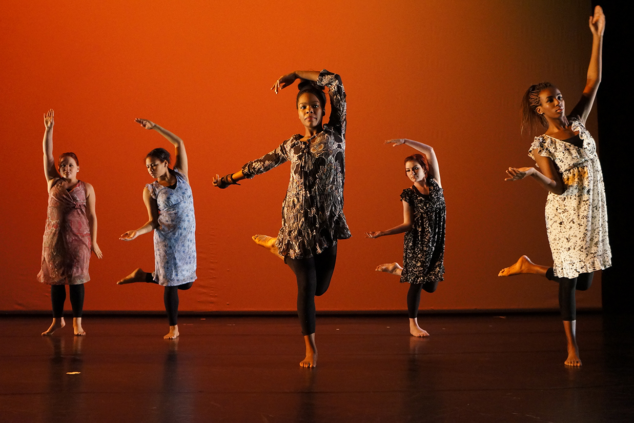 Female dancers on orange stage