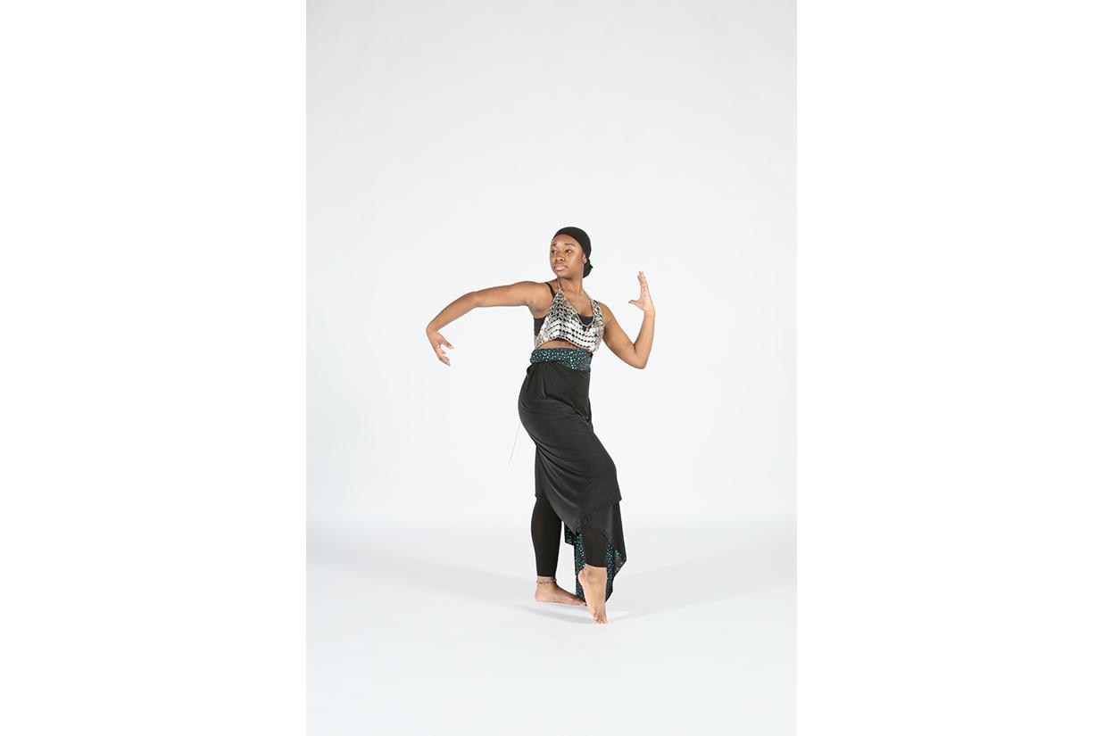Female dancer posing in costume