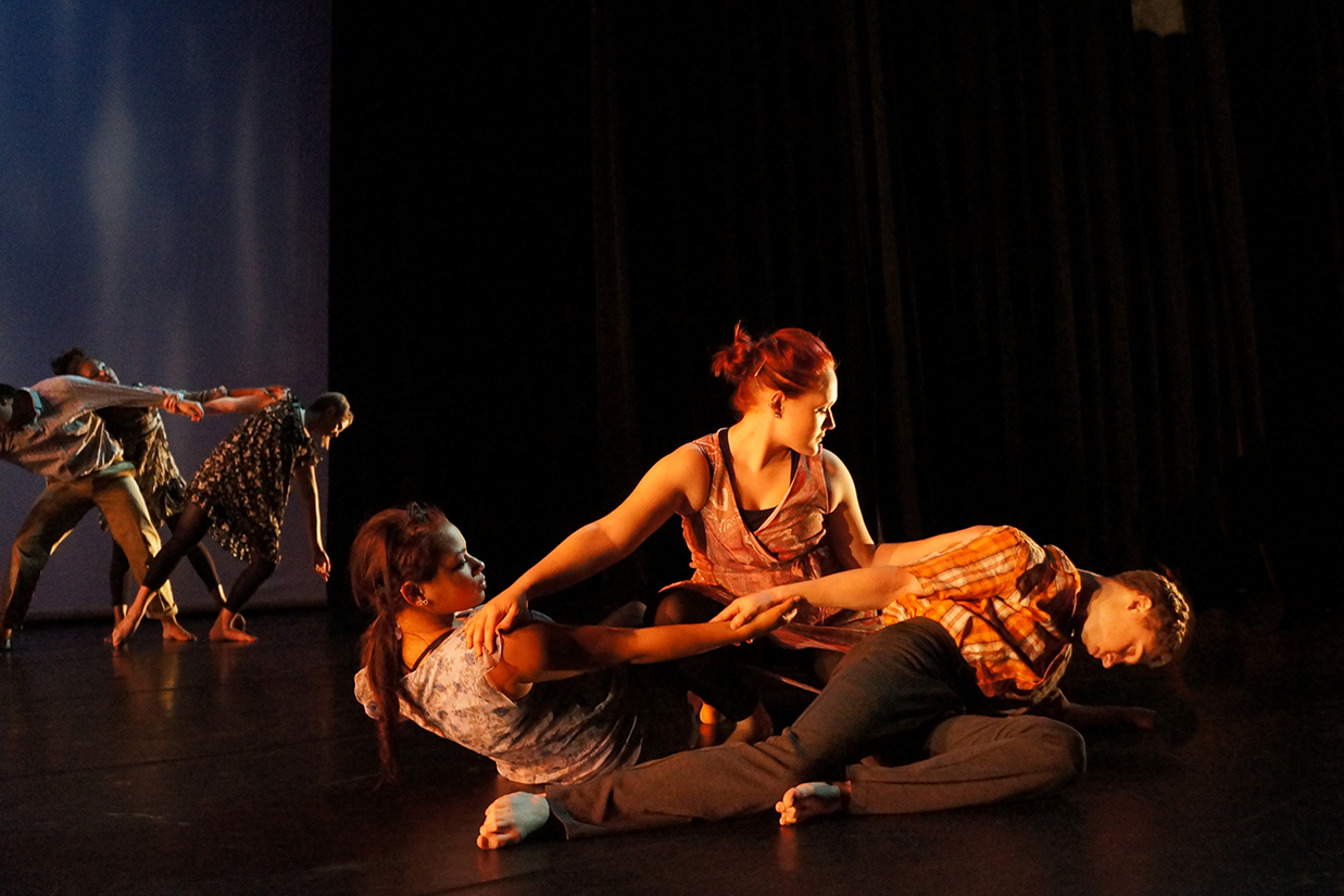 Intertwined dancers on stage